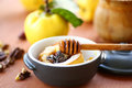 Baked quince with walnuts and honey in a baking dish Stock Photography