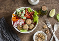 Baked quinoa meatballs and vegetable salad on a wooden table, top view.  Buddha bowl. Healthy, diet, vegetarian food concept. Royalty Free Stock Photo