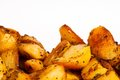 Baked or roasted potatoes closeup of hot delicious covered with flavorful seasonings Royalty Free Stock Images