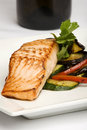 Baked salmon with eggplant and peppers Stock Image