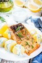 Baked salmon fillet and boiled potatoes Royalty Free Stock Photo