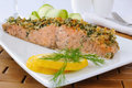 Baked salmon with a spicy crust parmesan Stock Photos