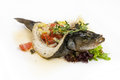Baked sea bass stuffed with vegetables Stock Photo