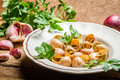 Baked snails with garlic butter closeup of on old wooden table Royalty Free Stock Image