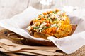 Baked stuffed sweet potato with rice Royalty Free Stock Photo