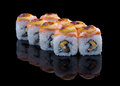 Baked sushi set with salmon eel and omelet on black background Royalty Free Stock Photography