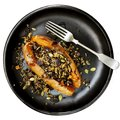 Baked Sweet Potato Stuffed With Wild Rice Seeds and Cranberries Royalty Free Stock Photo