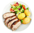 Baked tenderloin with salad Stock Photo