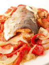 Baked trout with tomatoes and onion for mediterranean recipe studio Royalty Free Stock Images