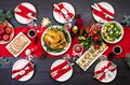 The Christmas table is served with a turkey, decorated with bright tinsel Royalty Free Stock Photo