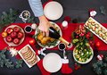 Baked turkey. Christmas dinner. The Christmas table is served with a turkey, decorated with bright tinsel and candles. Royalty Free Stock Photo