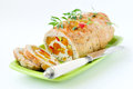 Baked turkey roll stuffed with dried apricots cherries and pist pistachios shallow depth of field selective focus Royalty Free Stock Photo