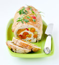 Baked turkey roll stuffed with dried apricots cherries and pist pistachios shallow depth of field selective focus Royalty Free Stock Photography