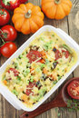 Baked vegetables with cheese in the pot on the table Royalty Free Stock Image