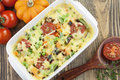 Baked vegetables with cheese in the pot on the table Stock Image