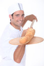 Baker baking bread some fresh Royalty Free Stock Image