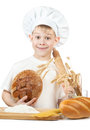 Baker boy with a loaf of rye bread and rolling pin Royalty Free Stock Photo