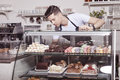 Baker and confectioner in pastry shop