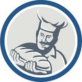 Baker hold bread loaf retro circle illustration of a chef cook holding of set inside on background done in style Stock Photos