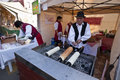 Baker make traditional Hungarian cake at a festival Royalty Free Stock Photo