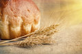 Bakery Bread and Sheaf of Wheat Ears. Still-life Royalty Free Stock Photo