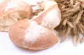 Bakery Bread with sheaf of Wheat Ears on white Royalty Free Stock Photo