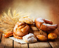 Bakery bread on a wooden table various and sheaf Stock Photo