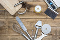 Bakery And Cooking Tools with kitchen timer, scales on wood table Royalty Free Stock Photo