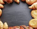 Bakery products arranged as frame on grey board Royalty Free Stock Image