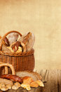 Bakery products in wicker basket on a wooden table Royalty Free Stock Image