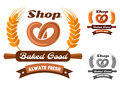 Bakery shop emblem or logo with pretzel in yellow orange and gray color variations showing fresh encircled wheat ears wooden Royalty Free Stock Images