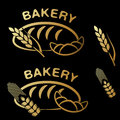 Bakery shop symbols. Golden simple icon of croissant, bread and spike grain on black background. Royalty Free Stock Photo