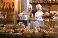 Bakery staff offering bread Royalty Free Stock Photo