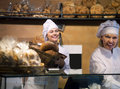 Bakery staff offering bread for sale Royalty Free Stock Photo