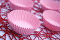 Bakeware for muffins some pink Royalty Free Stock Photo