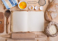 Baking background with blank cook book, eggshell, flour, rolling Royalty Free Stock Photo