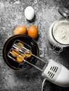Baking background. Blend eggs with a mixer to make a dough. Royalty Free Stock Photo
