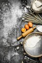 Baking background. Ingredients and tools for dough preparation.