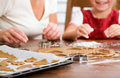 Baking christmas cookies Stock Photo