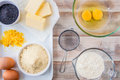 Baking ingredients for a lemon cake flour eggs butter ground almonds zest and poppy seeds Royalty Free Stock Photos
