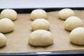 Baking sheet yeast dough balls baking paper Stock Image