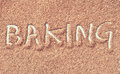 Baking spelt in capital letters in chocolate powder Royalty Free Stock Images