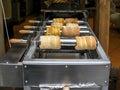 Baking of trdelnik pastry prague the sweet in lesser town Stock Images