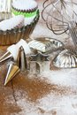 Baking utensils whisk cookie cutters tins icing tubes and cookie cups Stock Images
