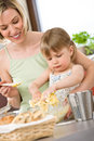 Baking - Woman with child preparing dough Stock Photography