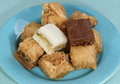 Baklava pile of assorted sweet on a blue plate Royalty Free Stock Photo