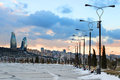Baku sunset in winter along the boulevard looking towards the city Stock Image