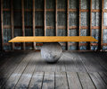Balance board in room a wooden on a round stone an old with wooden floors and stud walls Royalty Free Stock Image