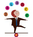 Balance man in business suit balancing juggling the word Stock Photo
