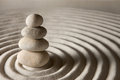 Balance stack of stones on sand background Royalty Free Stock Images